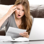 woman shocked at finances
